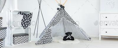 Teddy bear in tipi tent