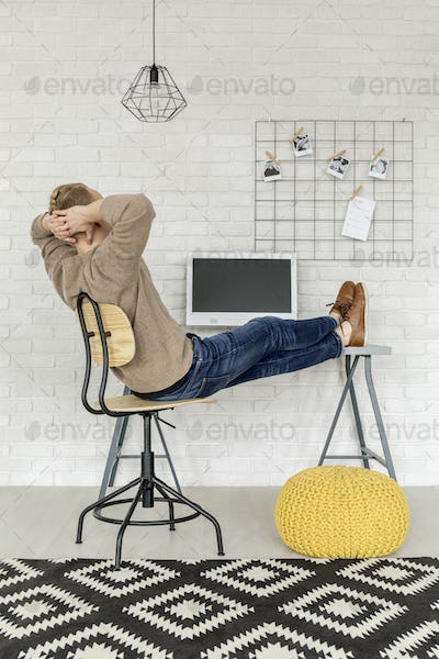 Student relaxing in a room