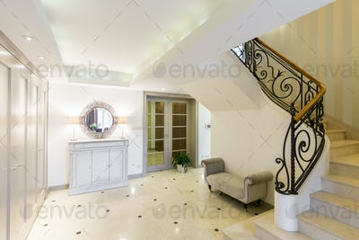 Elegant hallway with a stylish staircase