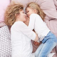 Mom and daughter on a bed