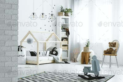 Child bedroom with brick wall
