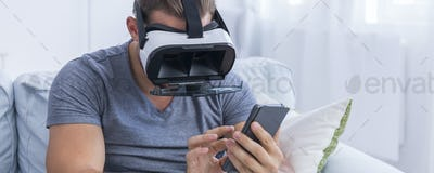 Man texting with VR glasses on