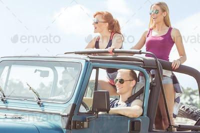 Friends having car trip