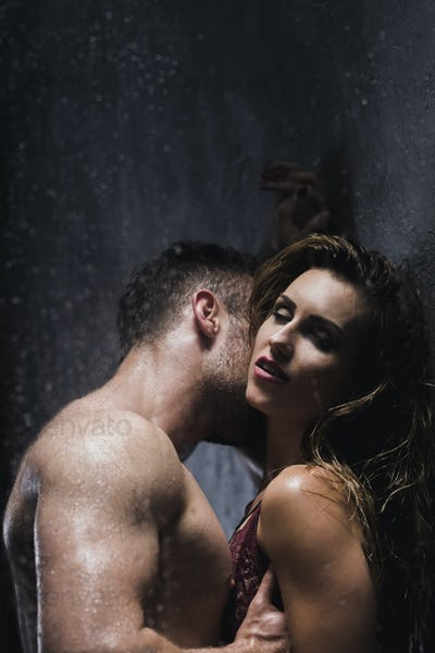 Couple kissing during foreplay at the bathroom