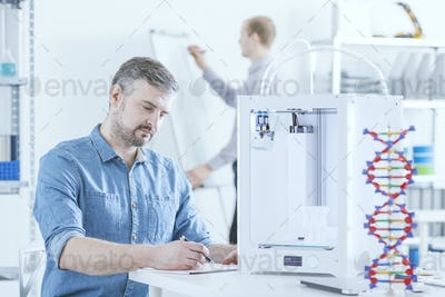 Man working using 3D printer