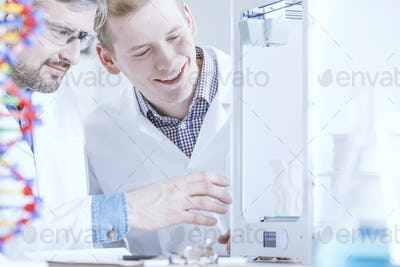 Scientists observing the 3D print