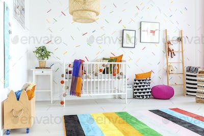 Colorful carpet in baby room