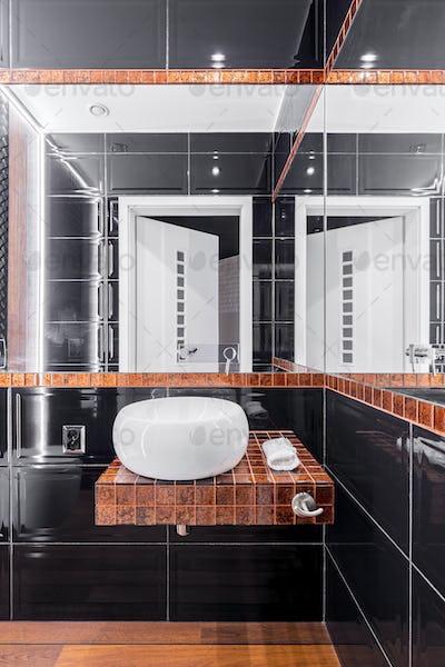 Black and copper bathroom