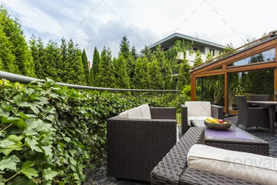 Terrace surrounded by lush garden