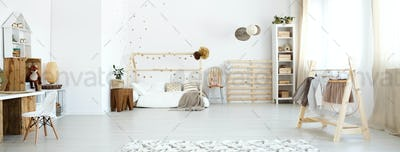 Baby room with wooden accessories