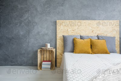 Grey bedroom with OSB bed
