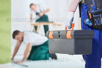 Worker keeping toolbox
