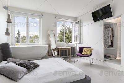 Multifunctional modern bedroom with bathroom
