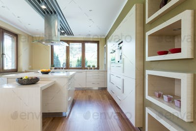 Modern kitchen with white fitted cabinets