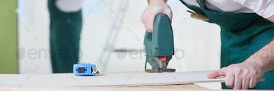 Carpenter using jigsaw