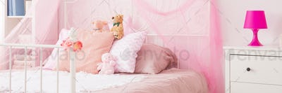 Little girl's bed with toys