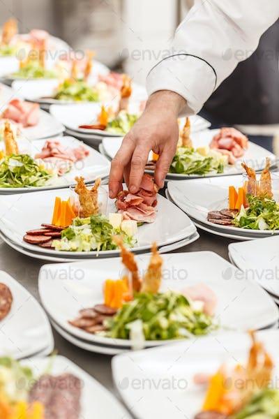 Cook prepare appetizer dishes