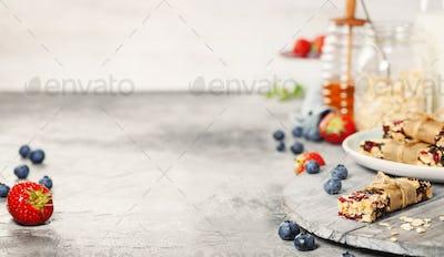 Granola bar on a grey rustic table