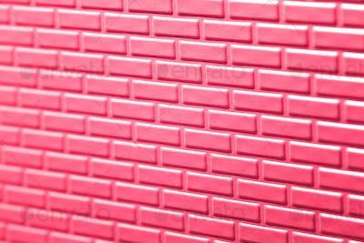 Wall of metallic bricks