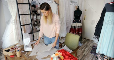Female using sewing patterns in atelier