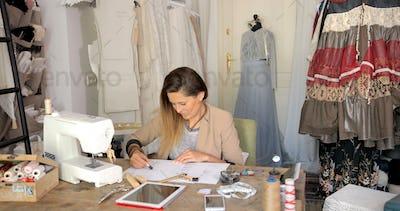 Dressmaker in process of working