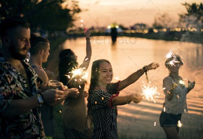 People Enjoying Sparkler in Festival Event