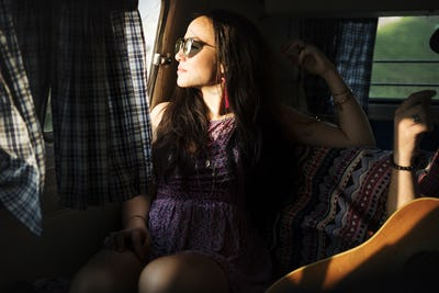 Woman Sitting Thoughtful in a Van Roadtrip
