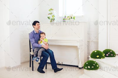 father and little son playing at home