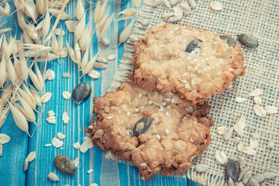 Vintage photo, Fresh baked oatmeal cookies and ears of oat, healthy dessert concept