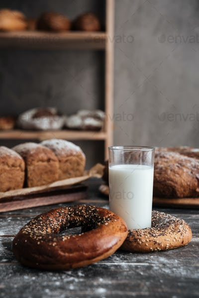 Pastries on dark wooden table and bread on background