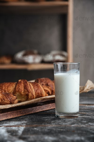 Pastries on wooden table with milk