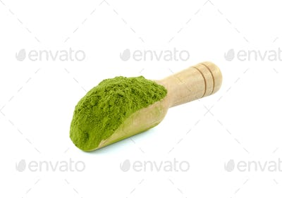 Tea powder in wood tea scoop.