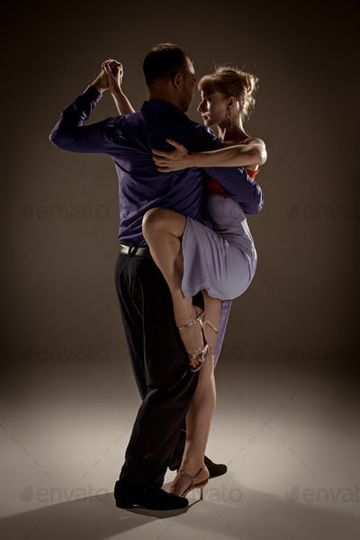 The man and the woman dancing argentinian tango