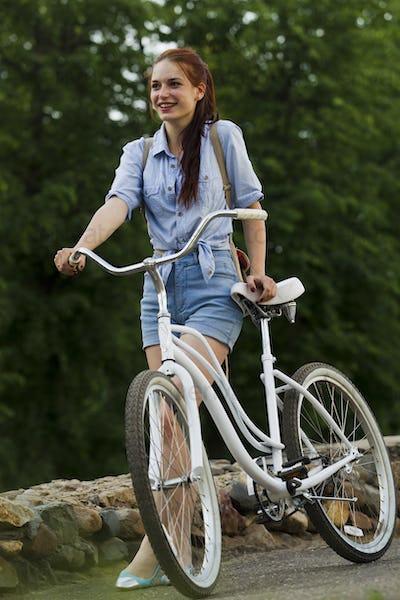 Girl and white bike