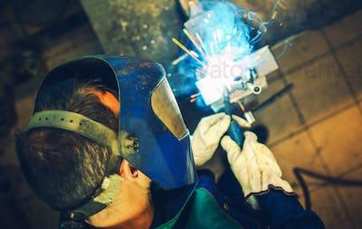 Welder and His Welding Job