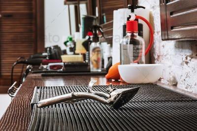 Barber shop equipment on wooden background.