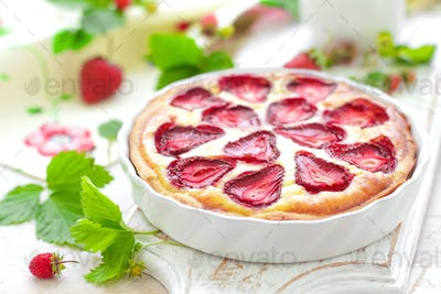 Delicious strawberry tart or cheesecake with fresh berries and cream cheese, closeup on white