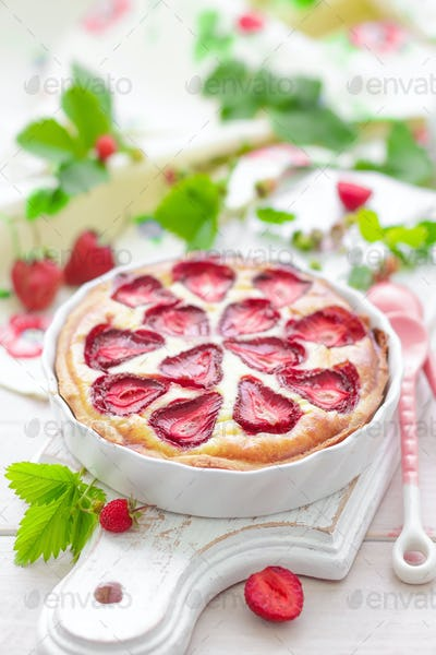Delicious strawberry tat or cheesecake with fresh berries and cream cheese, closeup on white