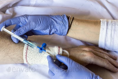Nurse injected antibiotics by via injection in a man admitted to hospital