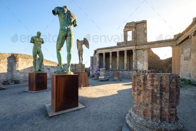 Scenic view of ruins and statues in ancient city of Pompeii
