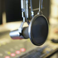 Close-up of a microphone in radio station broadcasting studio