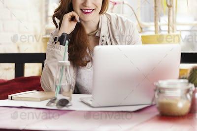 Female freelancer in coffee shop