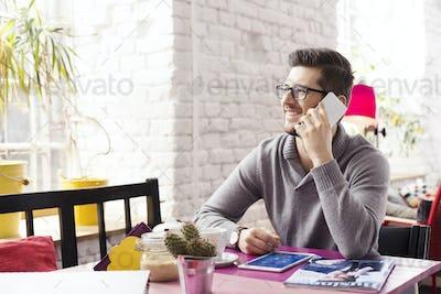 Freelancer talking on mobile phone