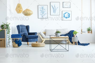 Room with navy blue armchair