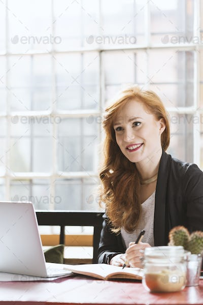 Woman having lunch in cafe