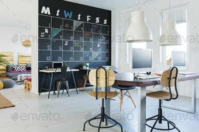 Open workspace with blackboard wall