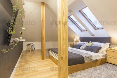 Bed in wooden bedroom