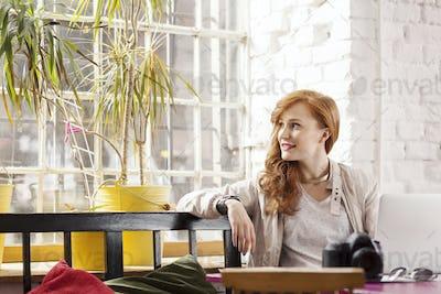 Woman sitting in loft apartment