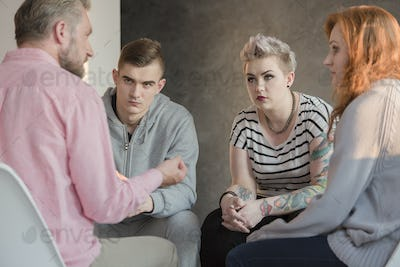 Psychologist talking with teenagers