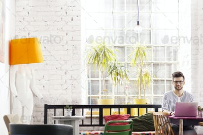 Hipster architect in industrial loft